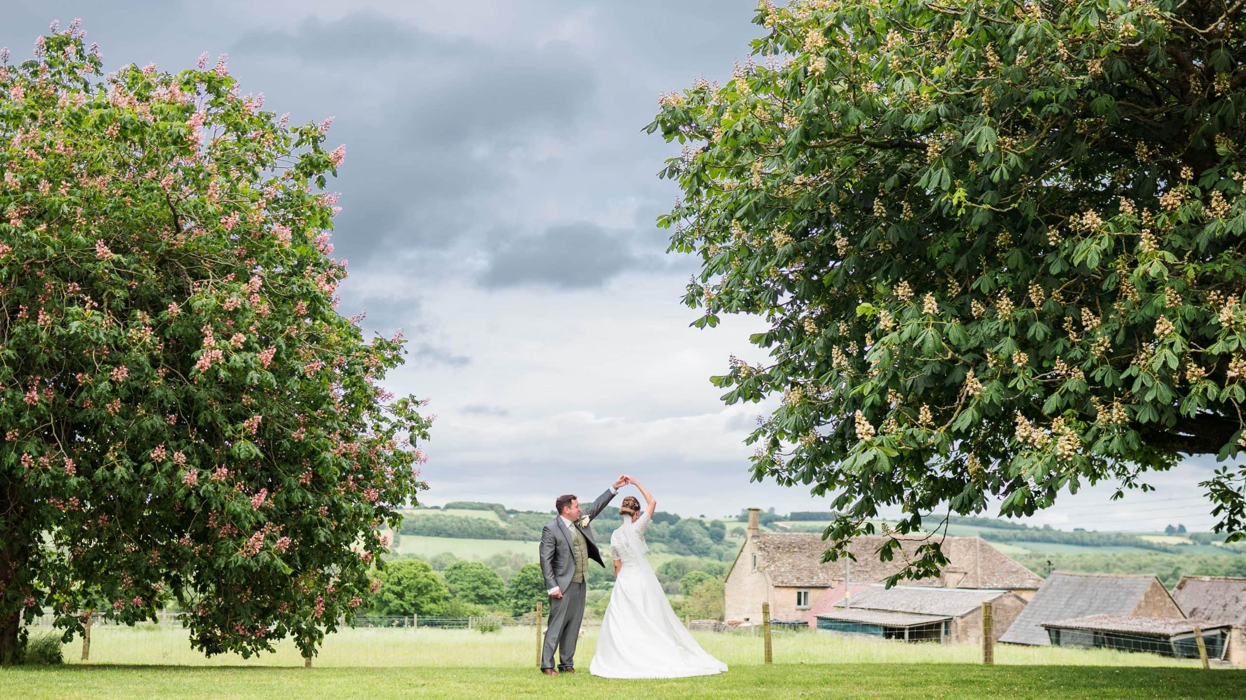 Lydia & Chris in the secret garden of The Barn at Upcote, Cheltenham wedding venue